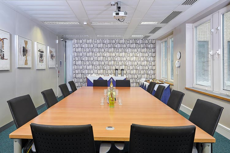 Meeting room with empty table and chairs